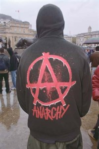 "A demonstrator wears a sweatshirt with ""Anarchy"" painted on the back during May Day riots in London. May 1, 2001 Westminster, London, England, UK"
